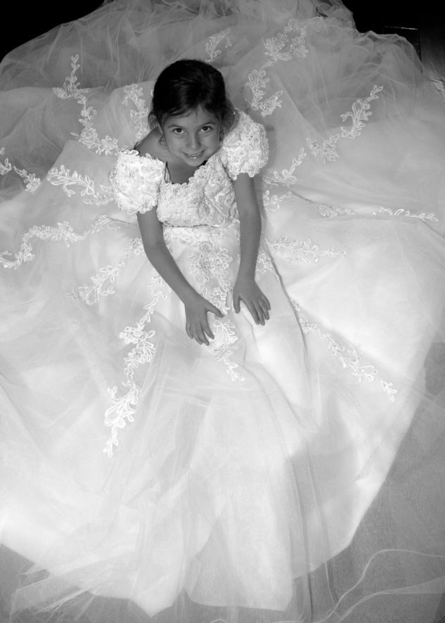 Daughter in mommy's wedding dress