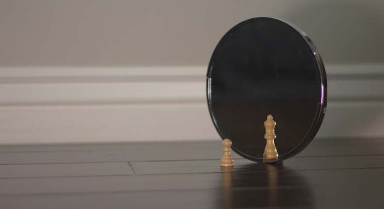 Chess pawn looking in mirror and sees queen photo