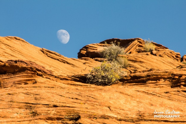 Photo of moon rising over the rocks