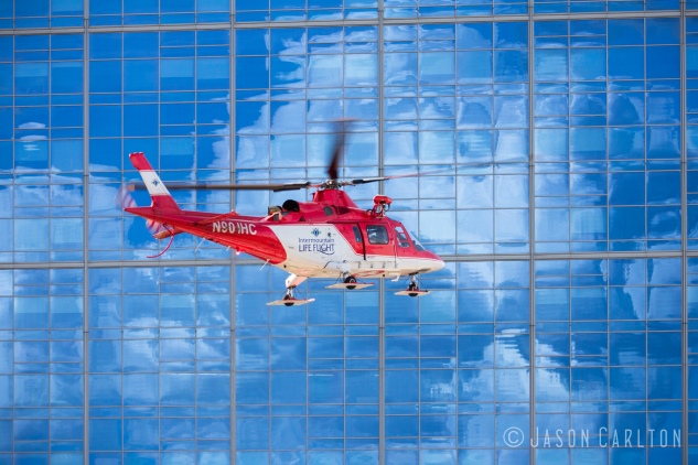 Life Flight Helicopter reflection sky clouds photo