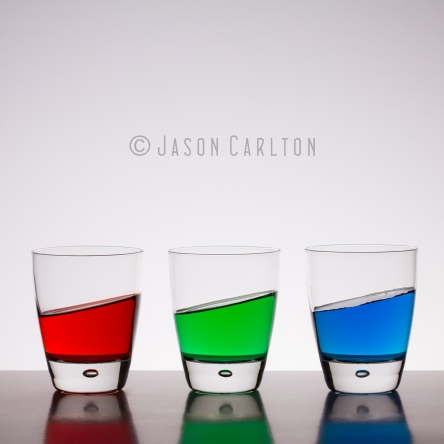 Glasses of red green blue water