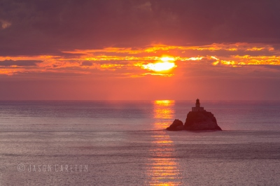 Photo at sunset of the Tillamook Rock Lighthouse in Oregon