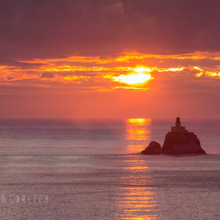 Photo at sunset of the Tillamook Rock Lighthouse in Oregon